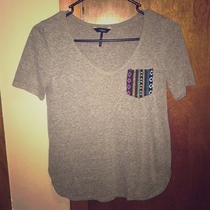 Nollie Brand gray V-neck with tribal stitch pocket